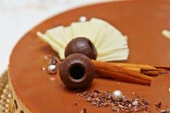 Chocolate cake. Chocolate cake with a chocolate ball and cinnamon Royalty Free Stock Photo