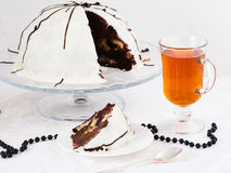 Chocolate Cake. A slice of  chocolate cake with cup of tea Royalty Free Stock Image