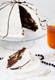 Chocolate Cake. A slice of chocolate cake with cup of tea Stock Images
