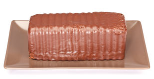 Chocolate Cake. One horizontal chocolate cake served in a brown plate. On white Stock Images