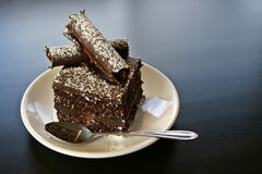 Chocolate Cake. A slice of chocolate cake on a white plate Royalty Free Stock Photography