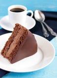 Chocolate cake. With creamy chocolate cream royalty free stock photos