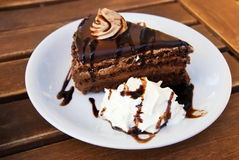 Chocolate cake. On a wooden table Royalty Free Stock Images
