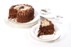 Chocolate Cake. German Chocolate Cake slice with whole cake in background Royalty Free Stock Images