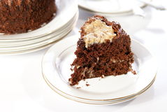 Chocolate Cake. German Chocolate Cake slice with whole cake in background Royalty Free Stock Photo
