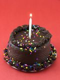 Chocolate Cake. With one lit candle in it Stock Photo