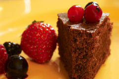 Chocolate cake. Piece of chocolate cake with red fruits stock photo