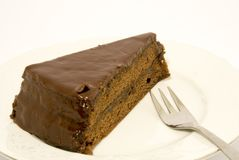 Chocolate cake. With a fork, placed over white Stock Photo