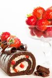 Chocolate Cake. With comport of fresh strawberries in background Stock Image