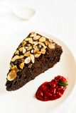 Chocolate cake with almonds and raspberry Stock Photos