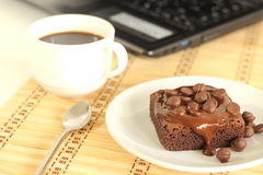 Chocolate Cake And Labtop Royalty Free Stock Photos