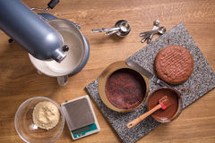Chocolate cake baking ingredients on kitchen table with kitchenware, top view Royalty Free Stock Images