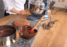 Chocolate cake baking ingredients on kitchen table with kitchenware, top view Stock Photography