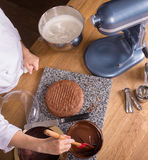 Chocolate cake baking ingredients on kitchen table with kitchenware, top view Stock Photos
