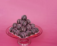 Chocolate cake balls stripped with pink candy melts stacked pyra Royalty Free Stock Images