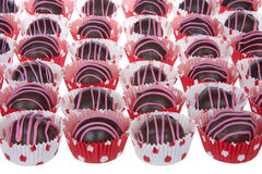 Chocolate cake balls stripped with pink candy melts Royalty Free Stock Image