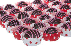 Chocolate cake balls stripped with pink candy melts Royalty Free Stock Photography