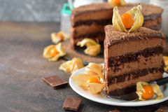 Chocolate cake with Bavarian mousse. On brown background stock image