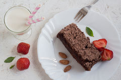 Chocolate Cake, Berries, Almonds, Milk and Mint Royalty Free Stock Image