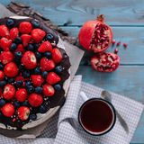 Chocolate cake with berries and mint on the stand royalty free stock photos