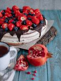 Chocolate cake with berries and mint on the stand royalty free stock images
