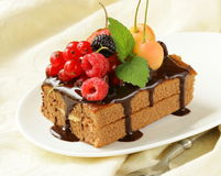Chocolate cake with berries (raspberry, currant, cherry). And chocolate sauce Royalty Free Stock Photo