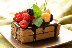 Chocolate cake with berries (raspberry, currant, cherry) Stock Photo