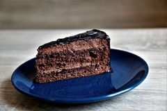 Chocolate cake on blue plate royalty free stock photography