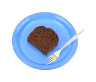 Chocolate cake on blue plate with fork Royalty Free Stock Image