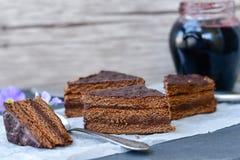 Chocolate  cake. Chocolate cake  and blueberry jam with purple flowers Stock Photo