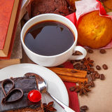 Chocolate cake and books Stock Images