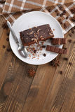 Chocolate cake  in a bowl on a wooden boards background Royalty Free Stock Photo