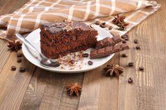 Chocolate cake  in a bowl on a wooden boards background Stock Photos