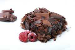 Chocolate cake (Brownie) with raspberry. Chocolate pie brings positive energy and makes us happier Stock Photo