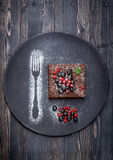 Chocolate cake brownie with summer berries. On  dark background Stock Photo