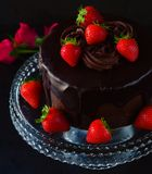 Chocolate Cake with butter cream icing. Chocolate Cake with butter cream ganache for easter,birthday anniversary or christmas.Garnished with strawberry cream stock image