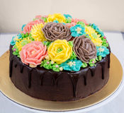 Chocolate cake with buttercream flowers Stock Photo