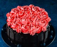 Chocolate Cake with buttercream rosset royalty free stock images