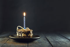 Chocolate cake with a candle and gifts.Happy Birthday, card. Holidays greeting card. Royalty Free Stock Photography