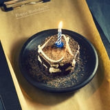 Chocolate cake with a candle and gifts.Happy Birthday, card. Holidays greeting card. Stock Photography