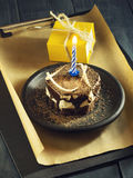 Chocolate cake with a candle and gifts.Happy Birthday, card. Holidays greeting card. Stock Photos