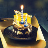 Chocolate cake with a candle and gifts.Happy Birthday, card. Holidays greeting card. royalty free stock photo