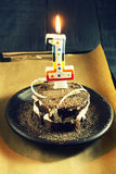 Chocolate cake with a candle and gifts.Happy Birthday, card. Holidays greeting card. royalty free stock images