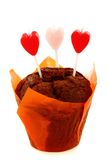 Chocolate cake and candles in the shape of heart. Royalty Free Stock Photography