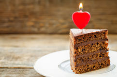 Chocolate cake with candles in the shape of a heart Royalty Free Stock Photos