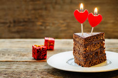 Chocolate cake with candles in the shape of a heart Royalty Free Stock Image