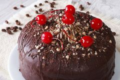 Chocolate cake with cherries and nuts. horizontal closeup Stock Image