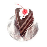 Chocolate cake with cherries on a plate foil on white background. Piece of layer cake on white background Stock Images