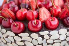 Chocolate cake with cherries. Royalty Free Stock Image