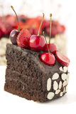 Chocolate cake with cherries. Stock Photos